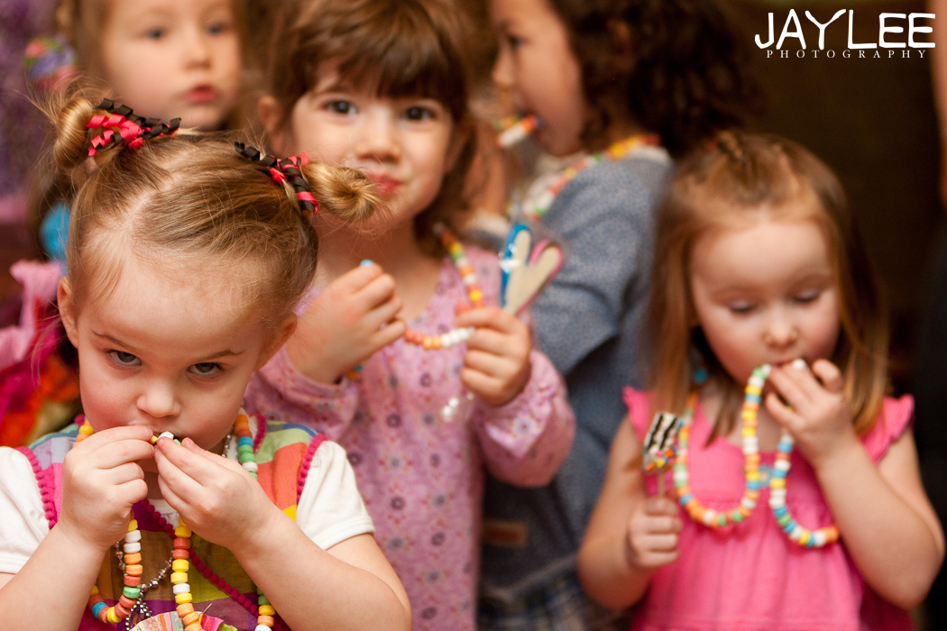 birthday party, 3 year old birthday party, girl's birthday party, rainbow birthday party theme, birthday party photographer seattle, seattle event photographer, seattle children's photographer, seattle kids photographer, seattle family photographer, kids eating candy necklaces