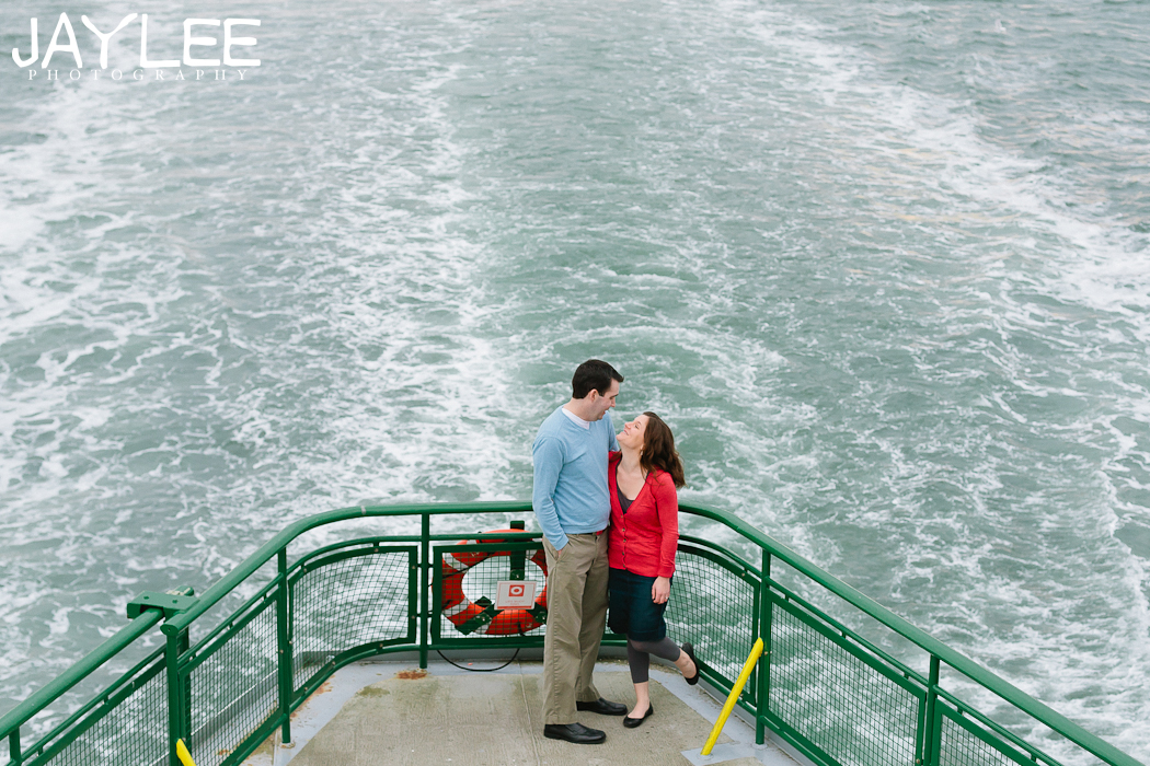 seattle ferry engagement, beautiful engagement photography, orange and blue engagement photos