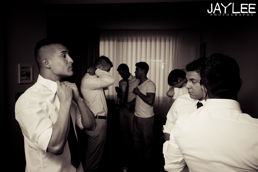 men getting ready, getting ready before the wedding, groom getting ready, groomsmen getting ready, black and white photography seattle, seattle wedding photographer