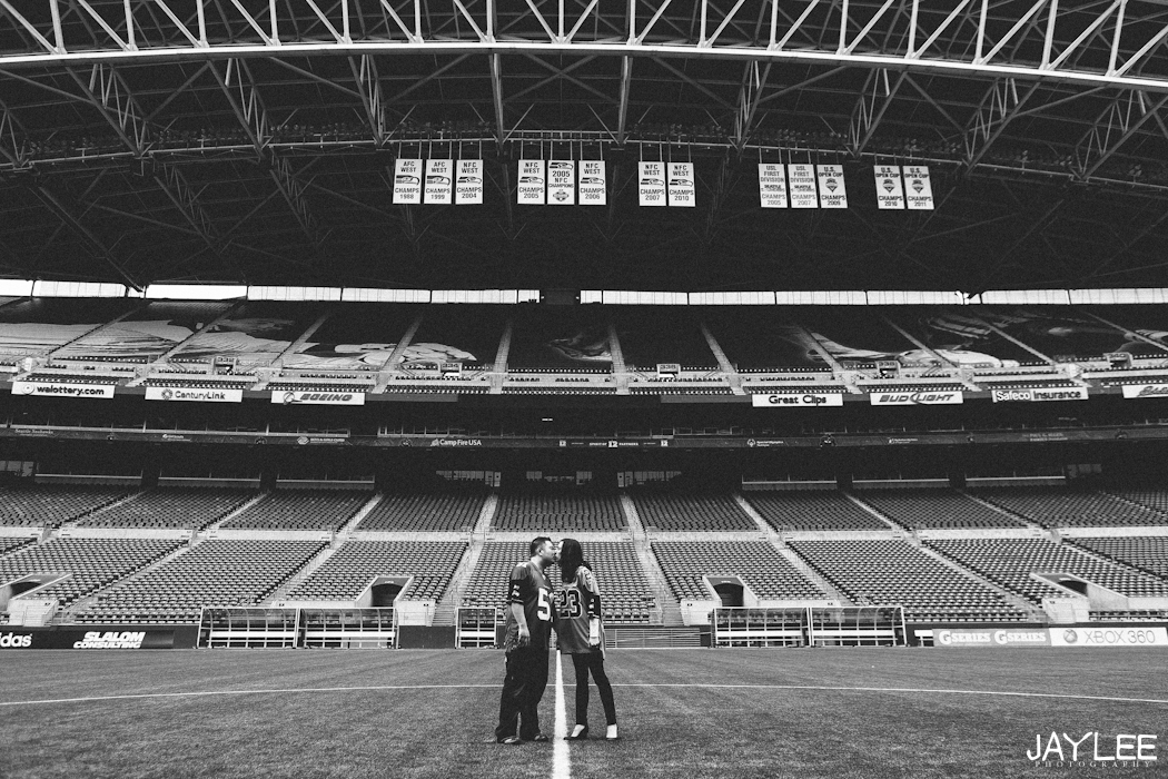 cardinals stadium seattle, seattle stadium, centurylink engagement, sports engagement session, seattle engagement, seattle engagement photographer, sports themed engagement, cardinals engagement session, centurylink field engagement, seattle wedding photographers, sports jerseys engagement