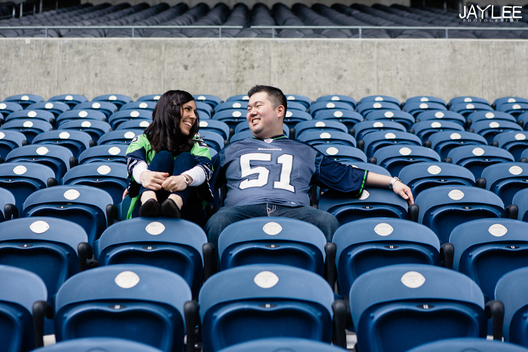 cardinals stadium seattle, seattle stadium, centurylink engagement, sports engagement session, seattle engagement, seattle engagement photographer, sports themed engagement, cardinals engagement session, centurylink field engagement, seattle wedding photographers, sports jerseys engagement, stadium stands, sitting in the stands