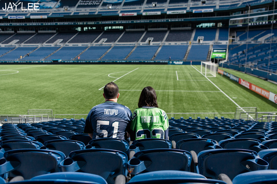 cardinals stadium seattle, seattle stadium, centurylink engagement, sports engagement session, seattle engagement, seattle engagement photographer, sports themed engagement, cardinals engagement session, centurylink field engagement, seattle wedding photographers, sports jerseys engagement, sitting in centurylink stands