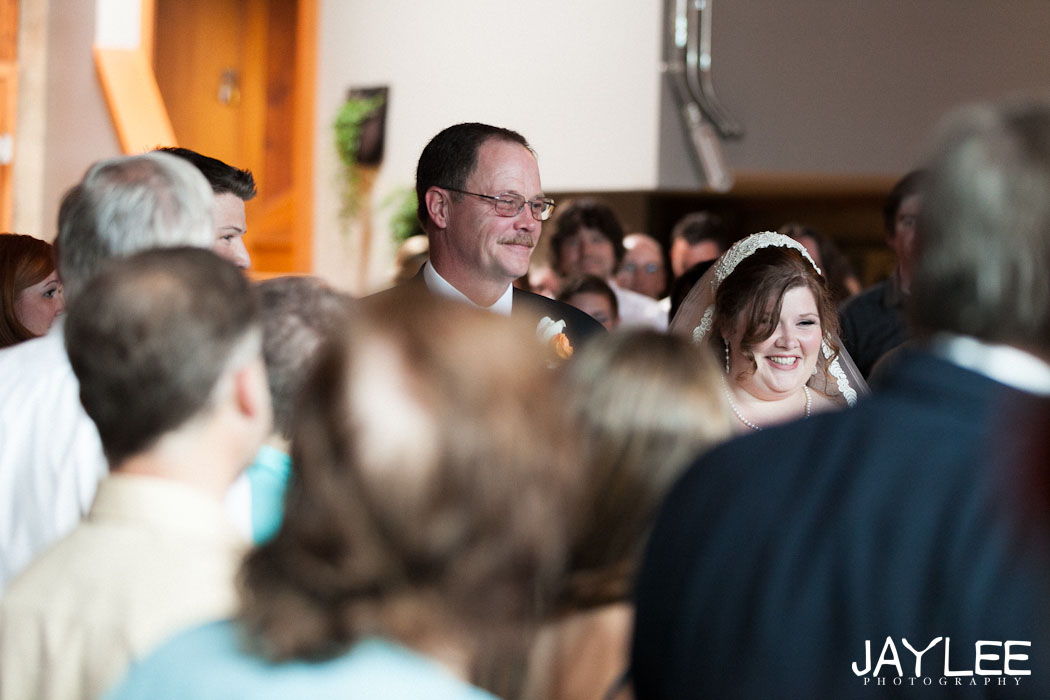 bride walking down the aisle, bride walking down the aisle seattle, seattle wedding ceremony photographer