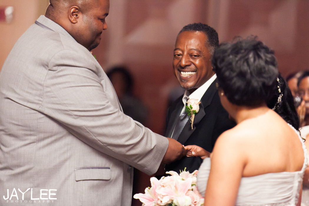 father handing off the bride