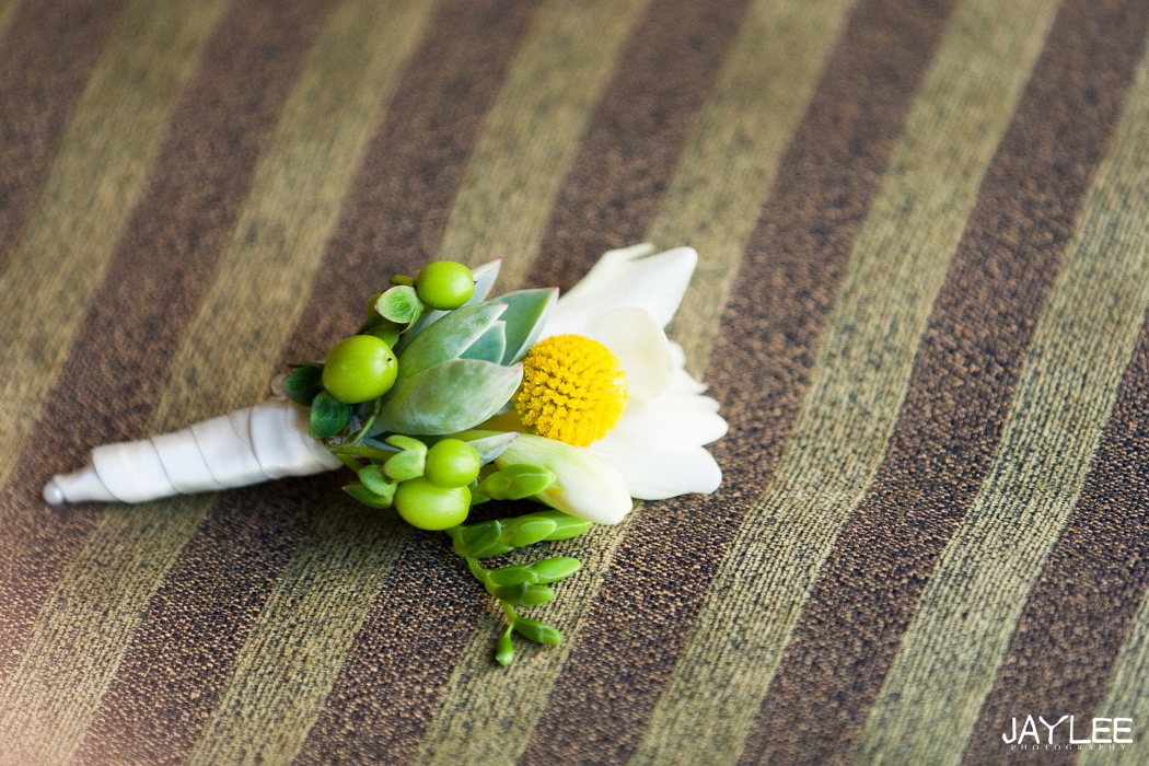 white and yellow summer groom's boutonniere