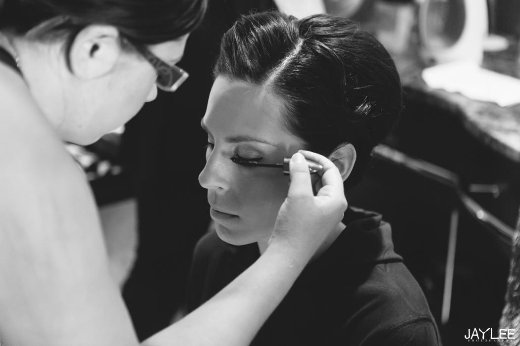 bride having makeup done at grand hyatt seattle