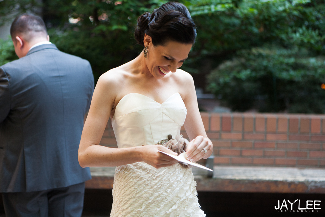 bride and groom exchange cards before first look downtown seattle