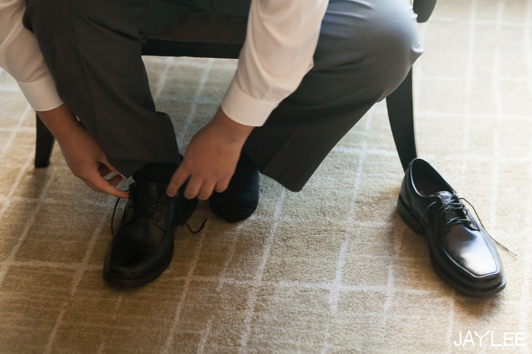 groom tying shoes at grand hyatt seattle
