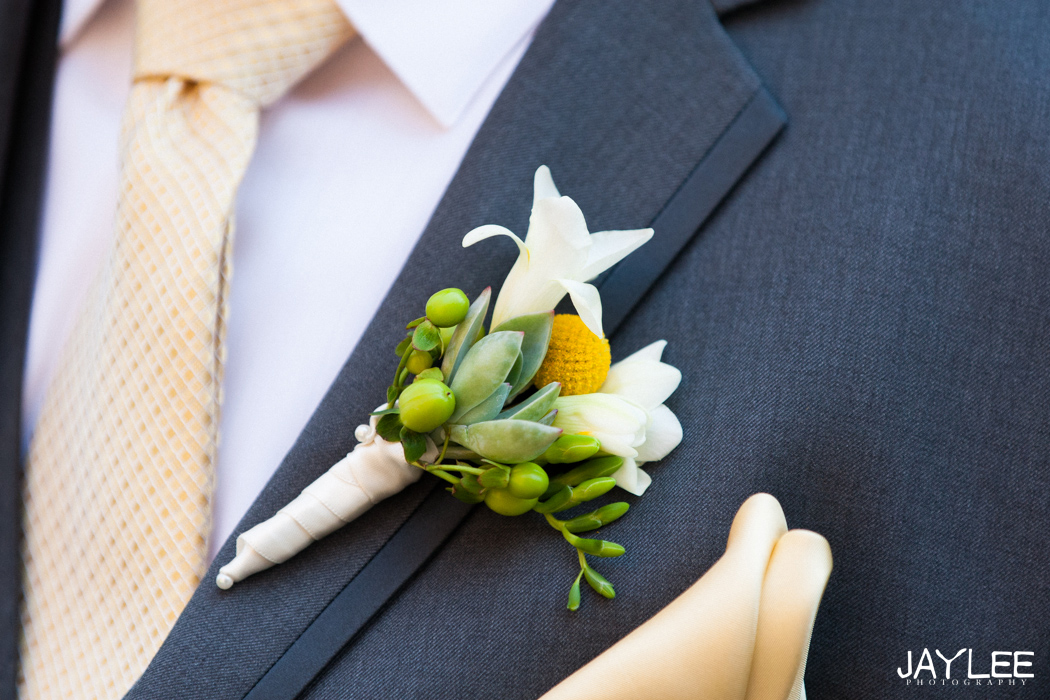 yellow and white groom boutonniere