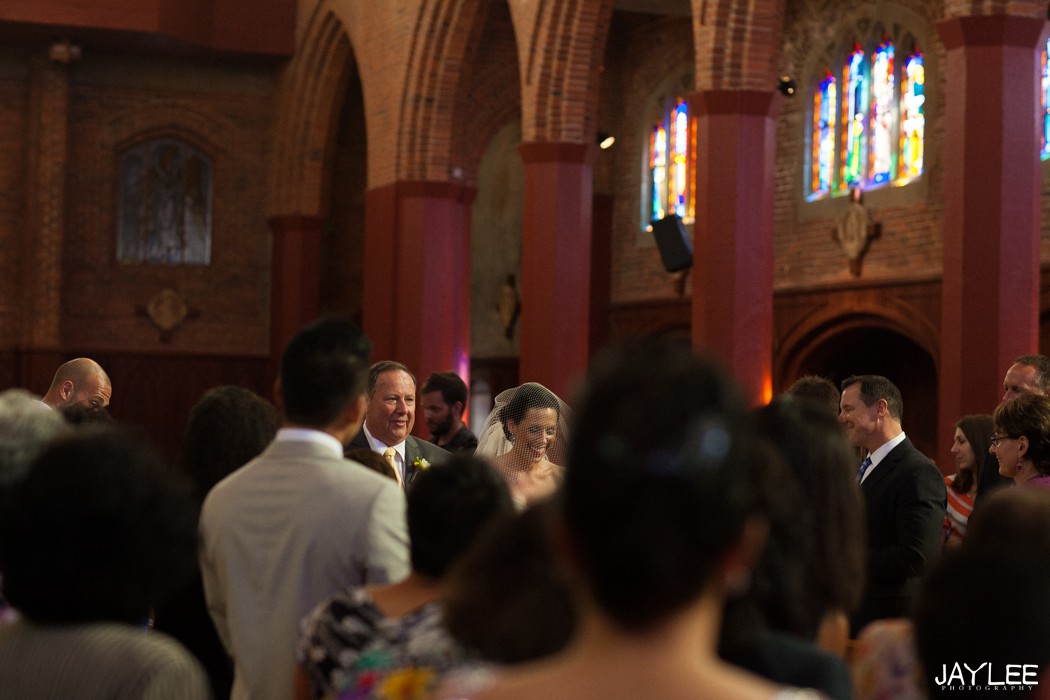bride and father walking down aisle at blessed sacrament in seattle, washington