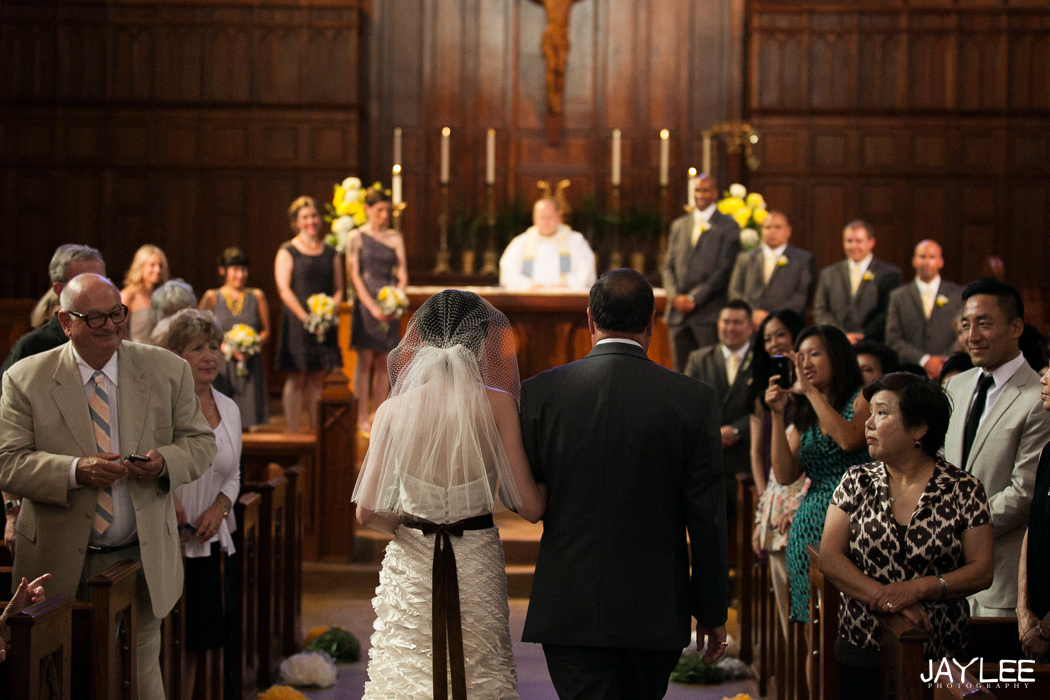 bride and father walking down aisle for catholic wedding ceremony in seattle, washington