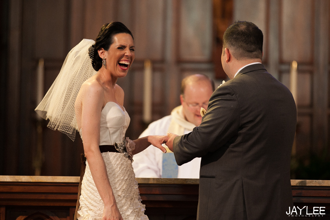 bride laughing during ring exchange at blessed sacrament seattle