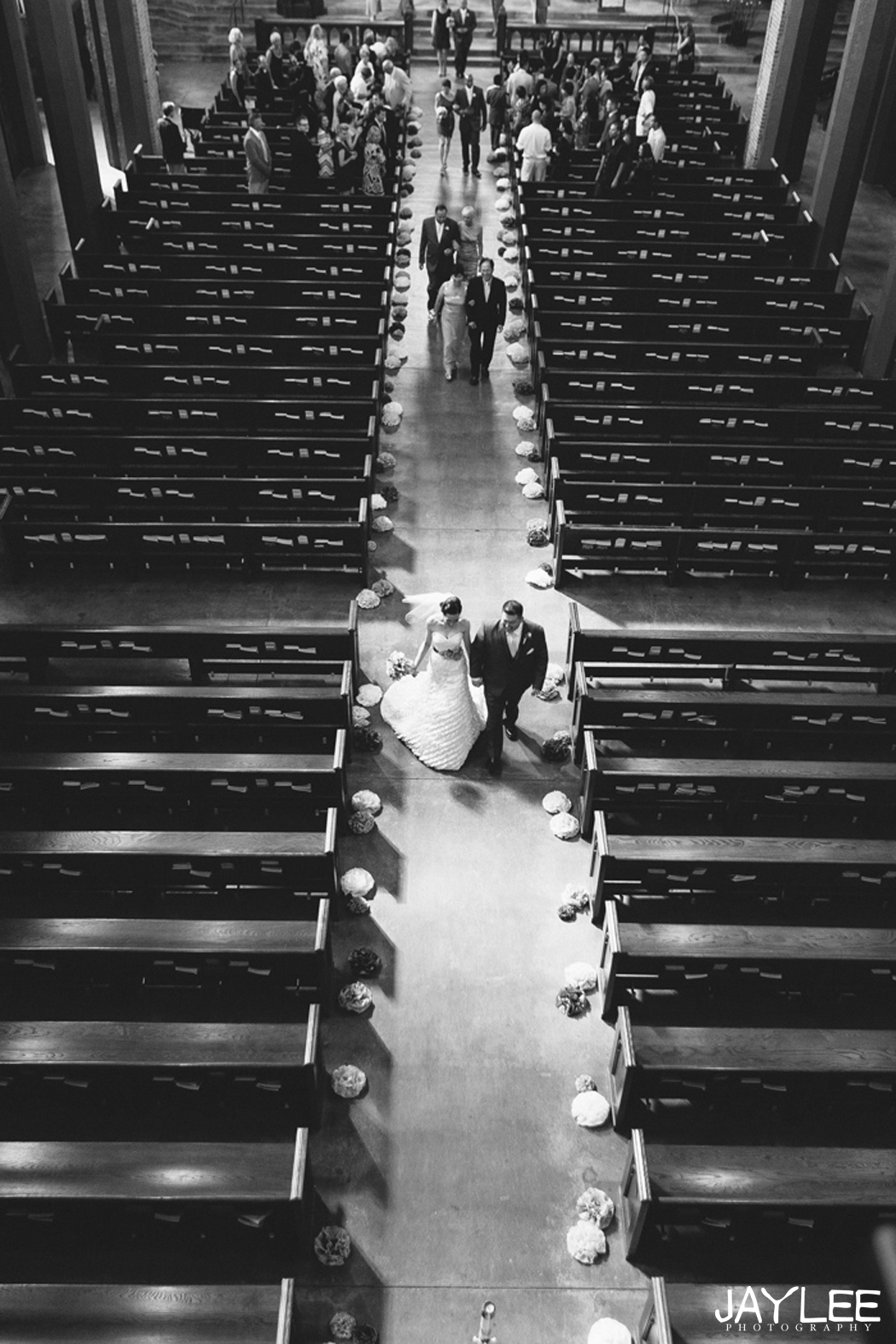 bride and groom walking down the aisle of blessed sacrament in seattle, washington