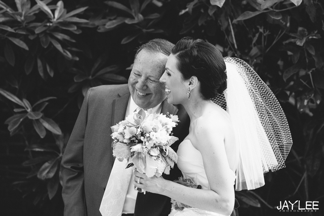 featured in seattle bride magazine a bride laughs with her father at blessed sacrament church