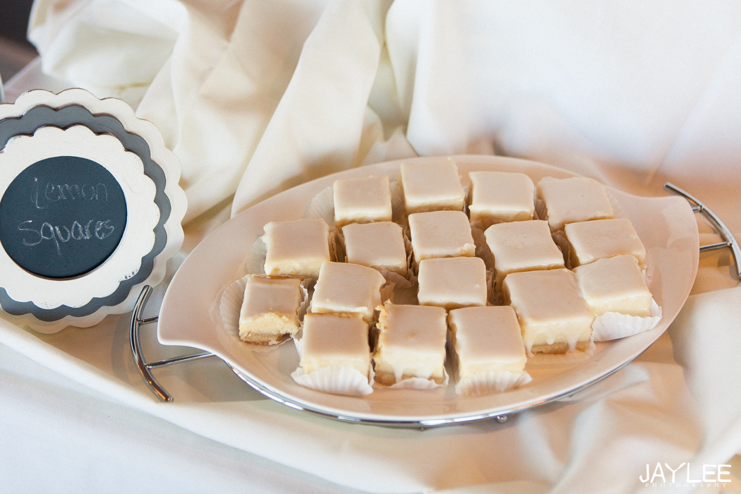 lemon bars on wedding reception dessert table