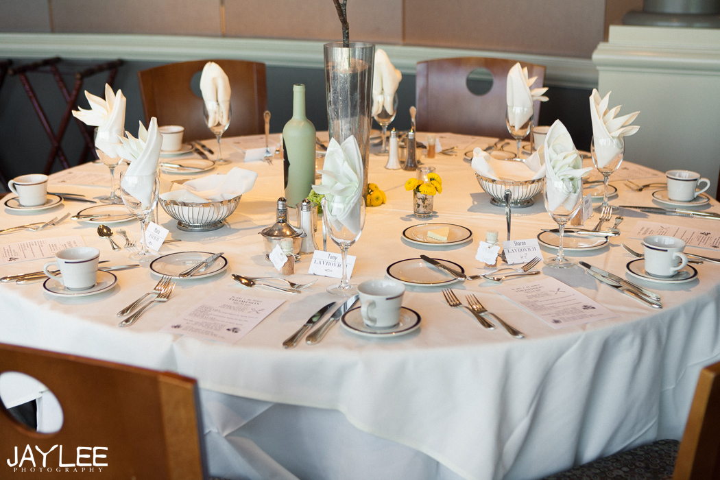 classy wedding reception tables at harbor club seattle