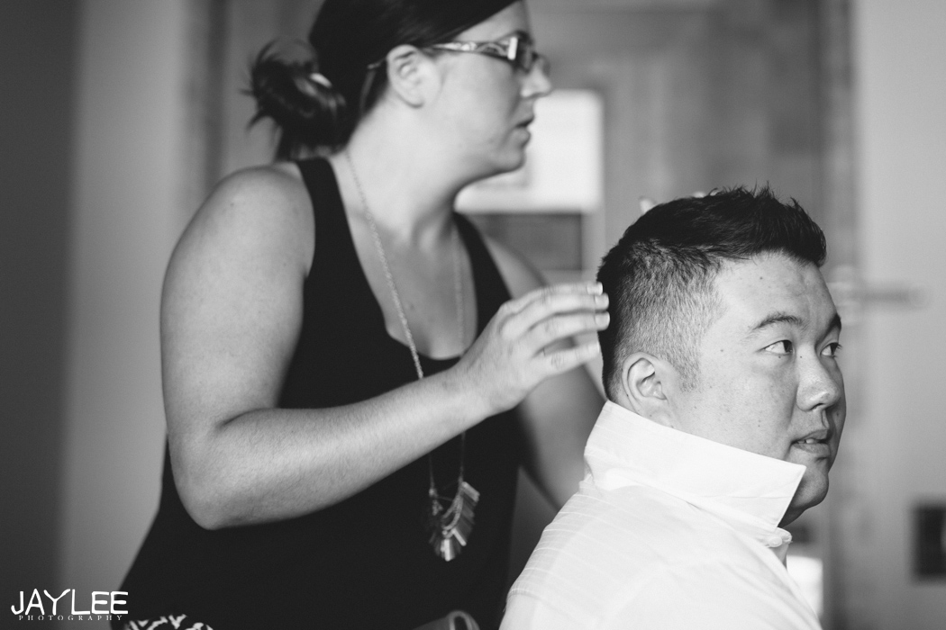 groom doing hair at grand hyatt hotel in seattle