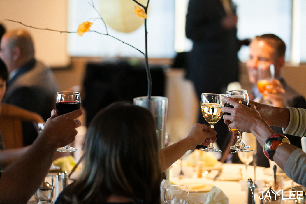 guests toasting at wedding reception at harbor club seattle