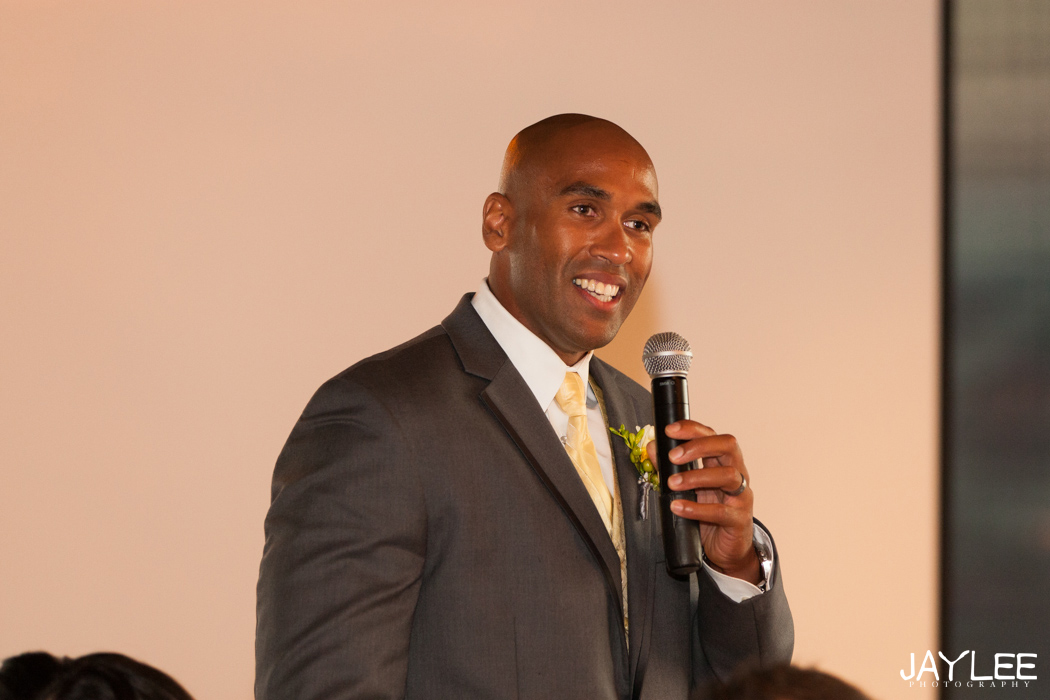 best man giving toast at wedding reception in seattle, washington