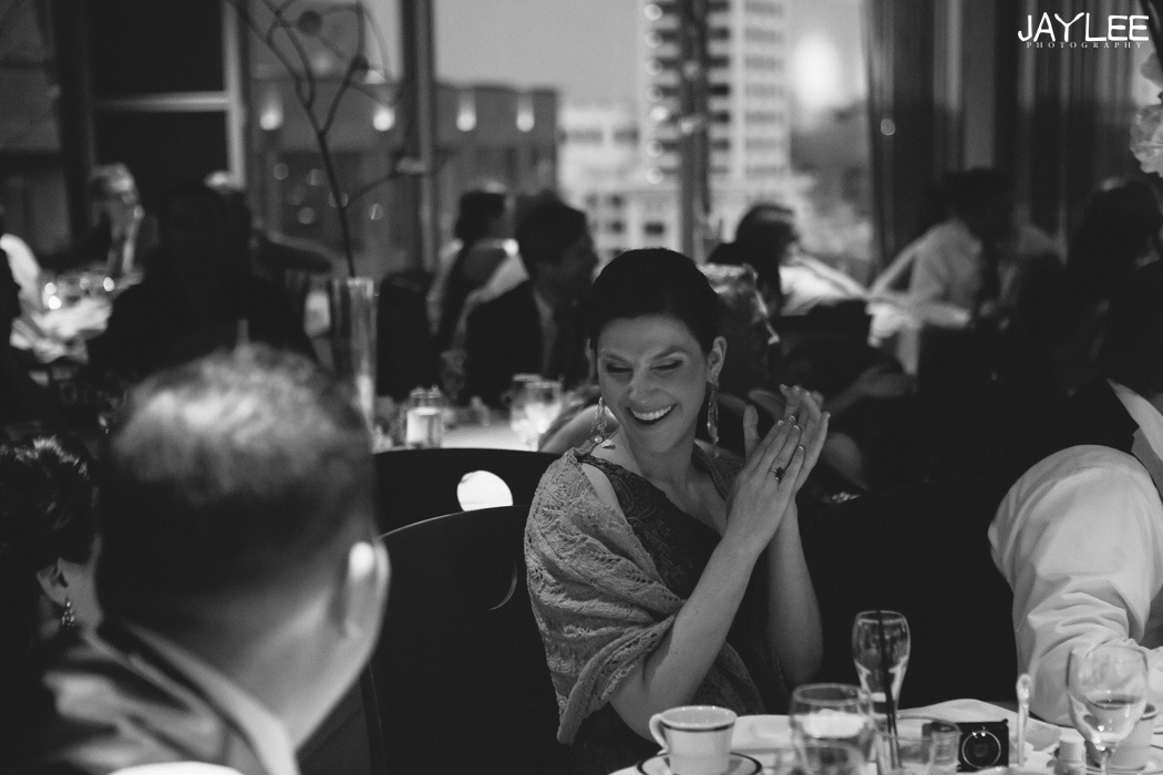 sister of bride laughing at wedding reception at harbor club seattle