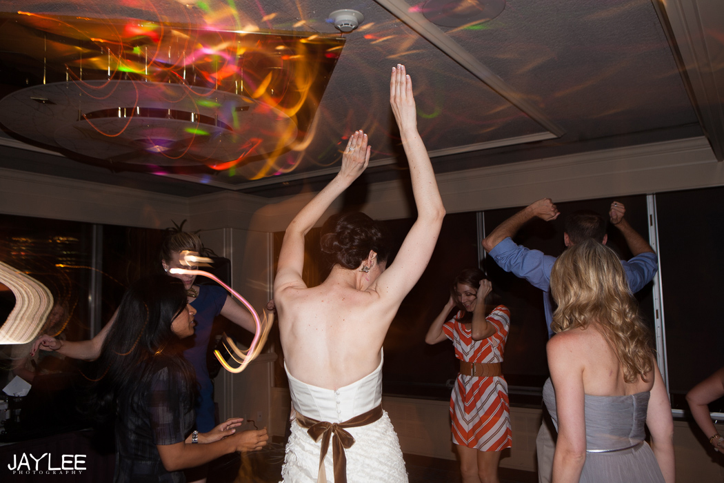 fun dance photos during wedding reception at harbor club seattle