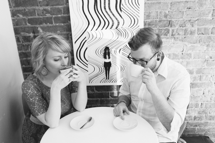 engaged couple sipping coffee at anchored ship coffee bar in seattle, washington