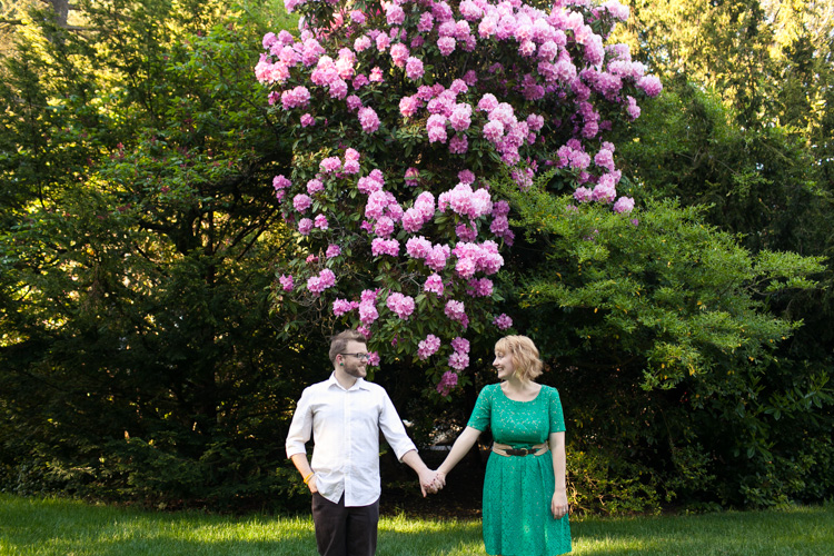 trees and flowers during engagement photo shoot in seattle, washington