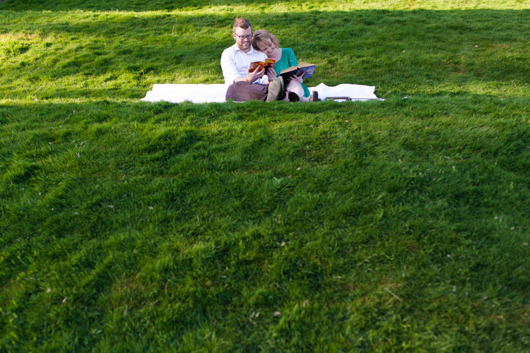 picnic blanket and books at the ballard locks for engaged couple