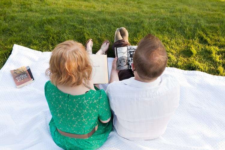 engaged couple reading books in a park in seattle, washington