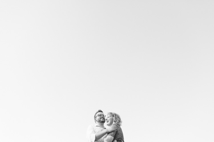 laughing couple during summer engagement session
