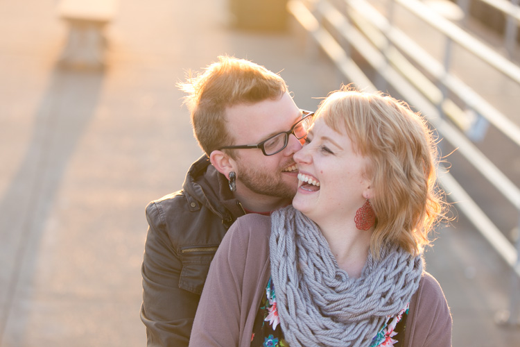 engaged couple laughing during seattle summer engagement session
