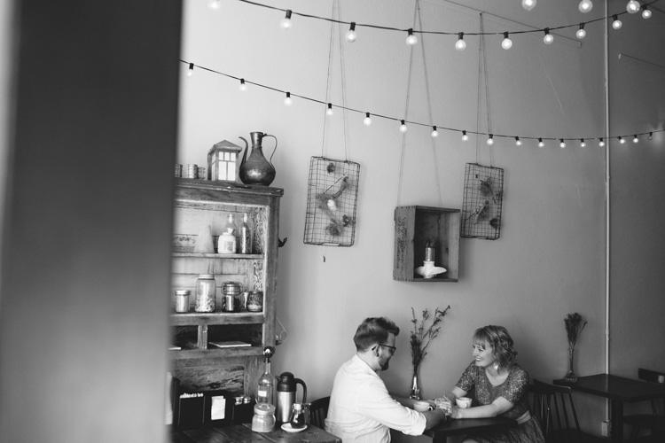 vintage engagement photos at anchored ship coffee bar in seattle, washington