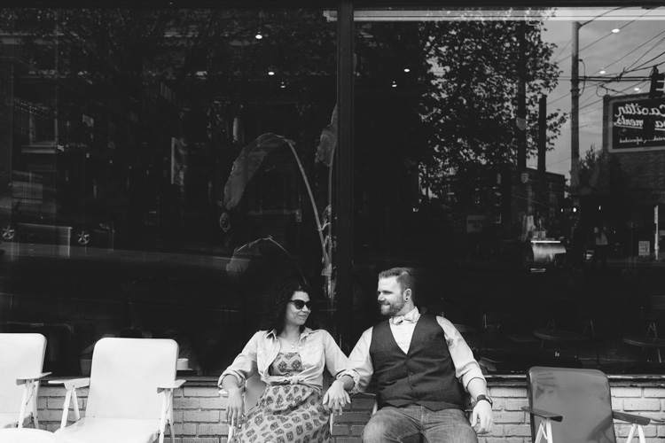 engagement photo session in front of bauhaus books in seattle, washington