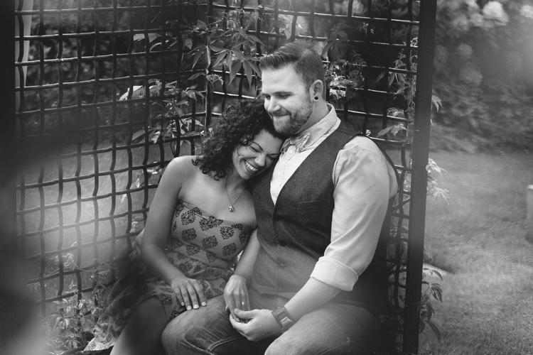 cuddly engaged couple during photo shoot in seattle, washington