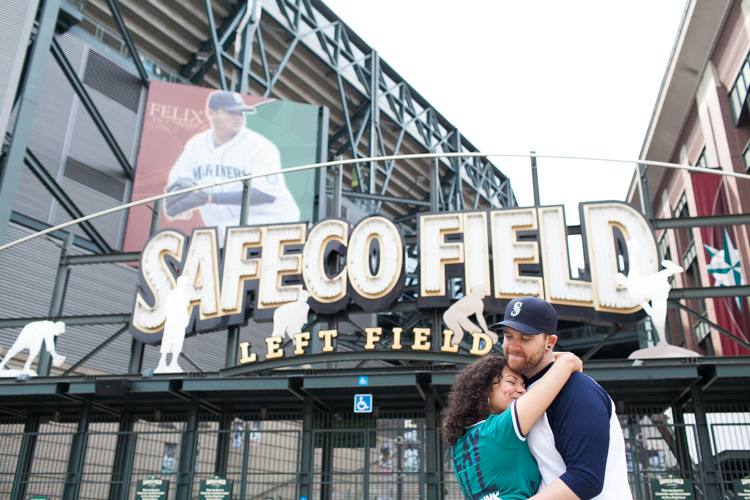 engaged couple at seattle mariners safeco field