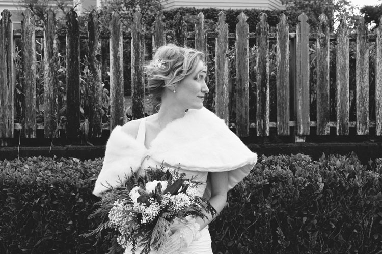 classy bride in white shrug shawl with lace gloves and messy updo
