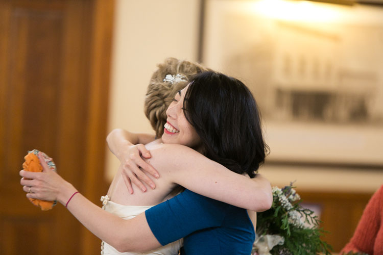 bride hugging guest in steilacoom, washington wedding