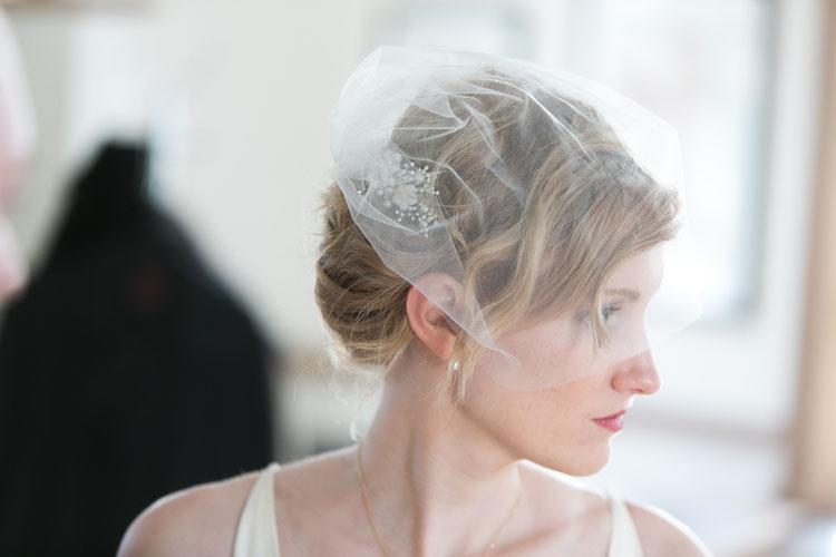 white Tulle birdcage wedding veil