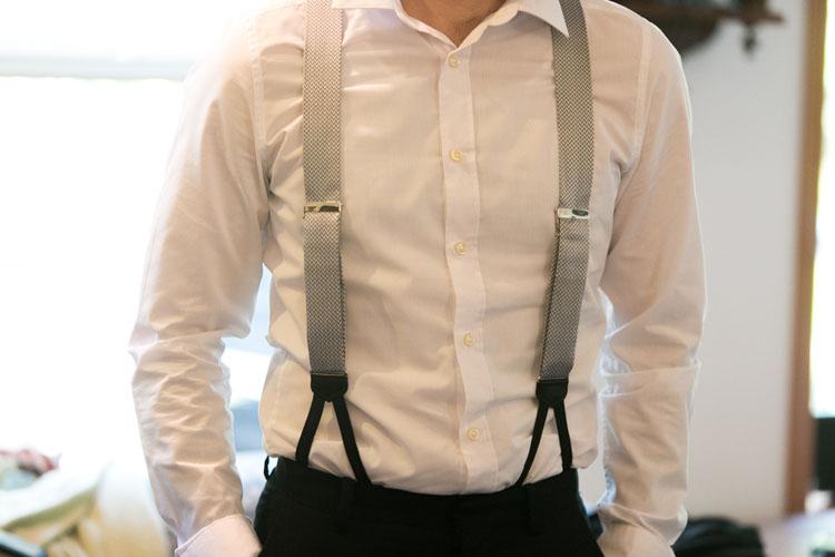 groomsmen in grey suspenders