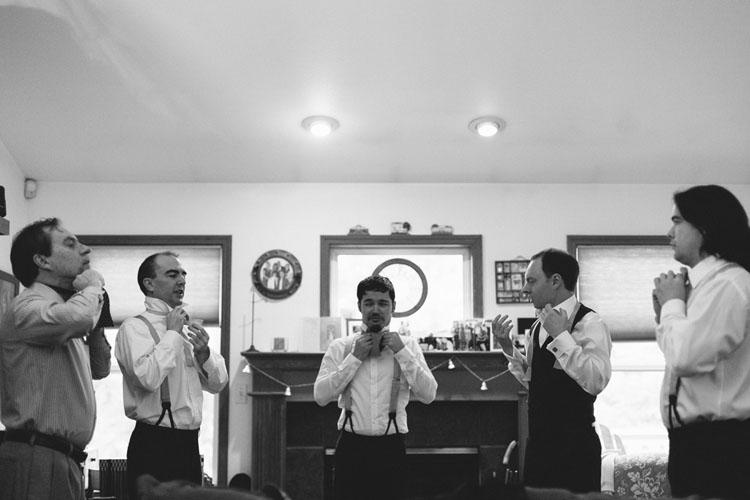 groomsmen learning to tie bow ties