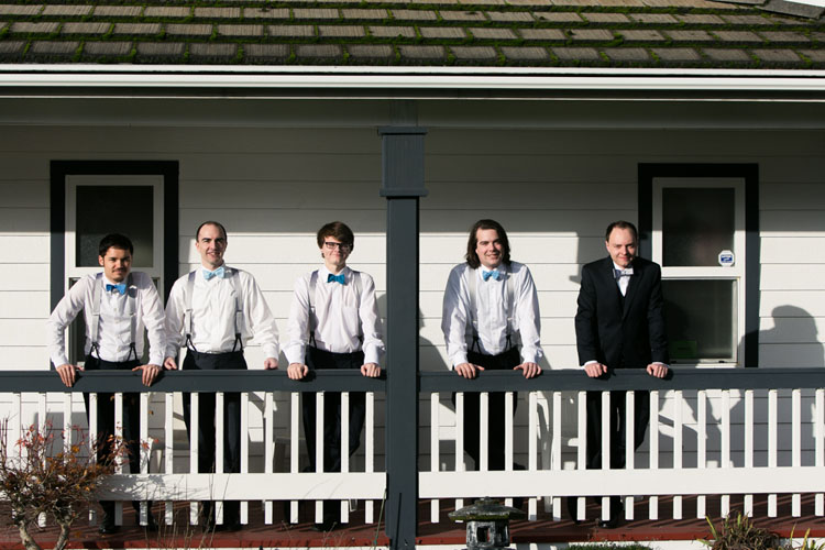 groom and groomsmen on porch