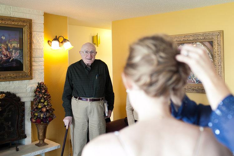 smiling grandpa seeing bride
