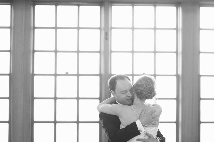 bride and groom hugging in steilacoom, washington