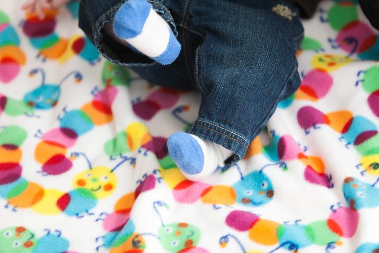 baby feet in blue socks