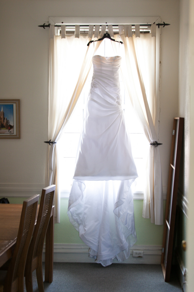 bridal gown in window long train