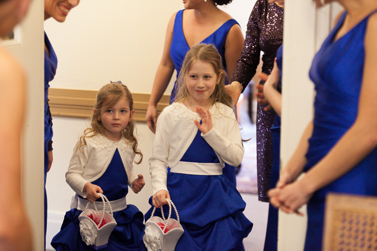 flowergirls in blue dresses with white jackets