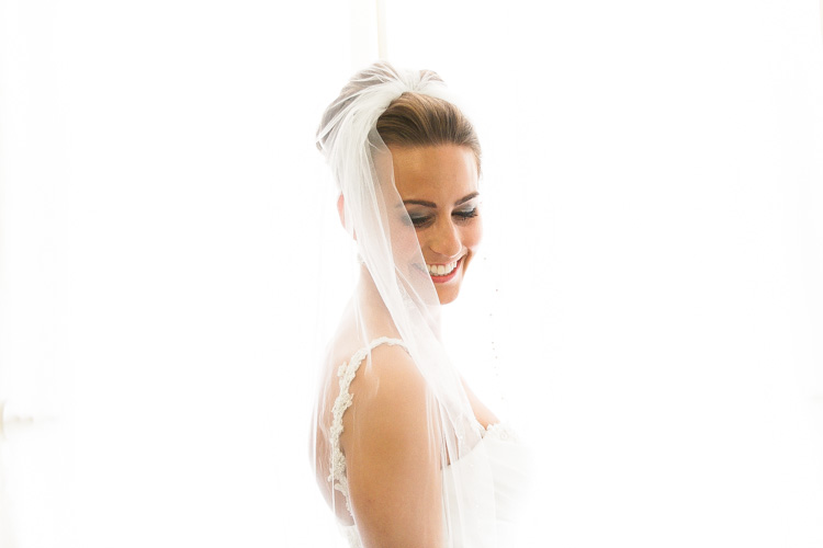 smiling bride with long veil