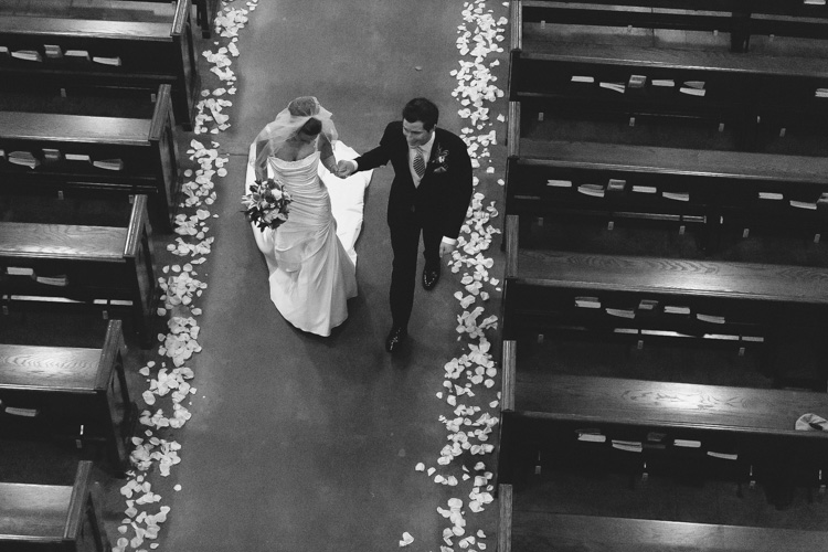 bride and groom walking down the aisle blessed sacrament