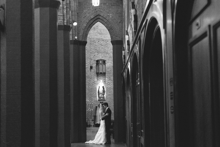 bride and groom hugging blessed sacrament seattle