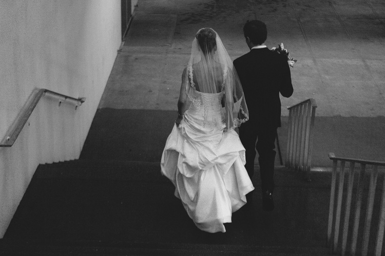 bride and groom walking down stairs in seattle, washington
